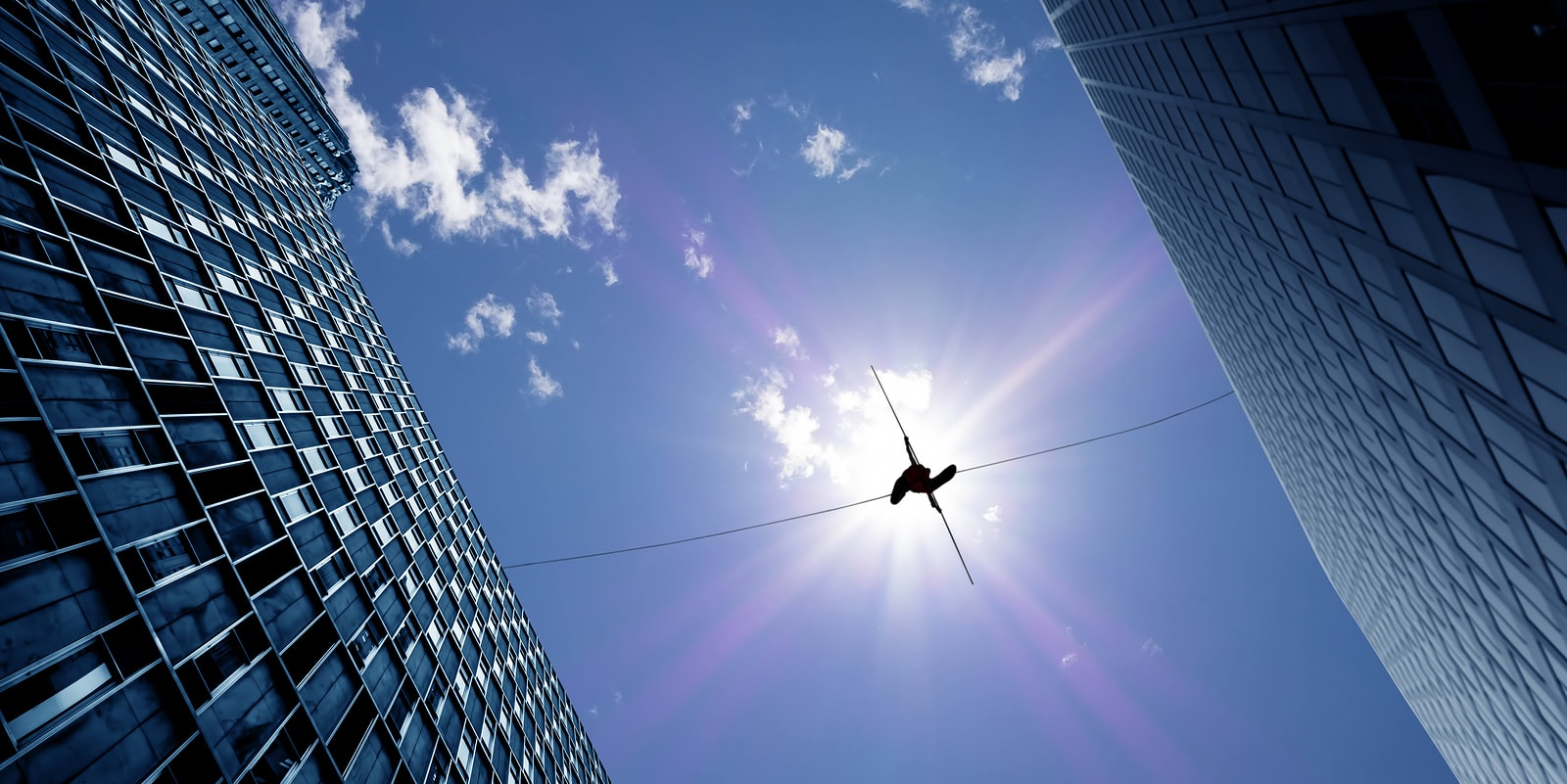 tightrope walker over city