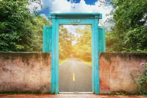 bright blue door leading to open road